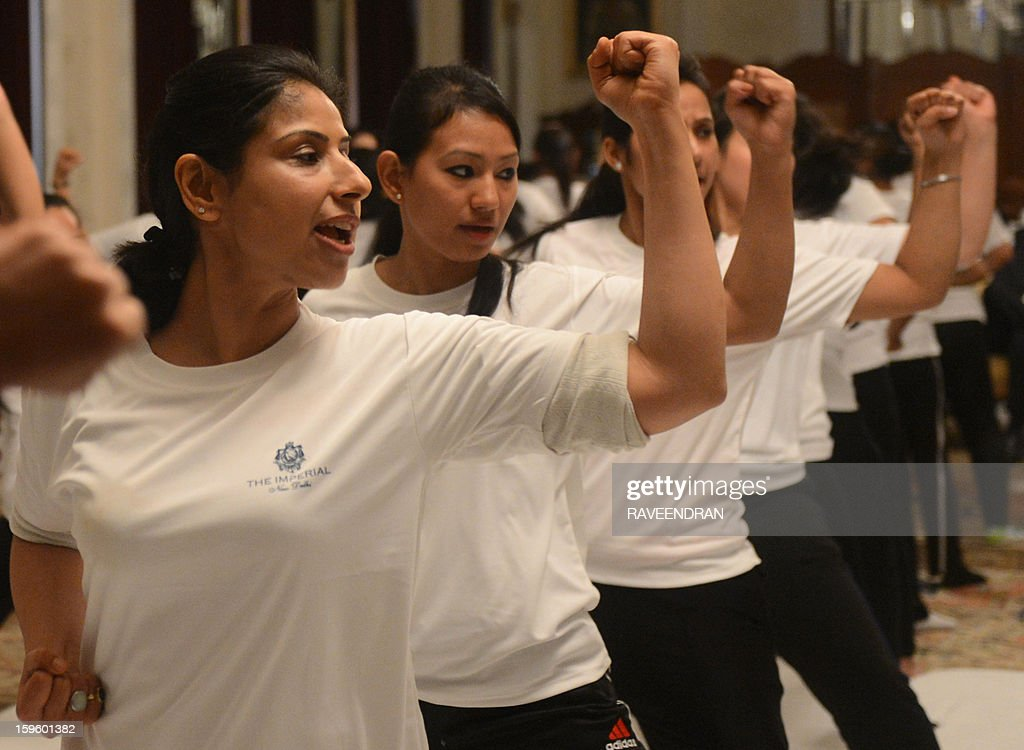 Female staff from the Imperial Hotel perform moves during a self-defence class led by Delhi Police in New Delhi on January 17, 2013. After One-month of lurid reporting on a horrifying gang-rape and murder of a student in New Delhi, women in the Indian capital say they are more anxious than ever, leading to a surge in interest in self-defence classes. AFP PHOTO/RAVEENDRAN