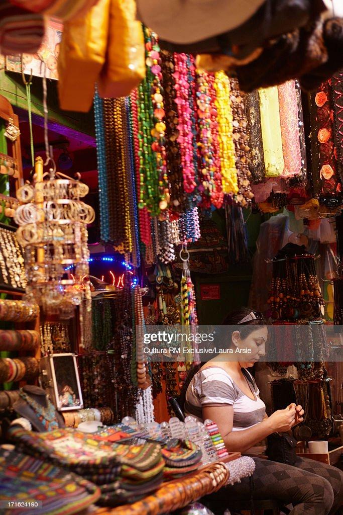 Female stall holder at market in Akko, Israel
