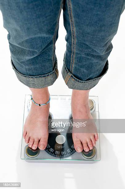 female standing on a scale