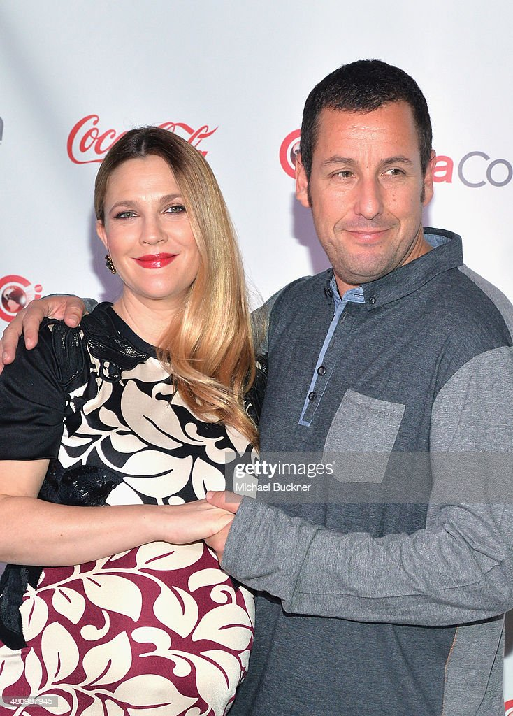 Female Star of the Year award winner Drew Barrymore (L) and Male Star of the Year award winner Adam Sandler attend The CinemaCon Big Screen Achievement Awards brought to you by The Coca-Cola Company during CinemaCon, the official convention of the National Association of Theatre Owners, at The Colosseum at Caesars Palace on March 27, 2014 in Las Vegas, Nevada.