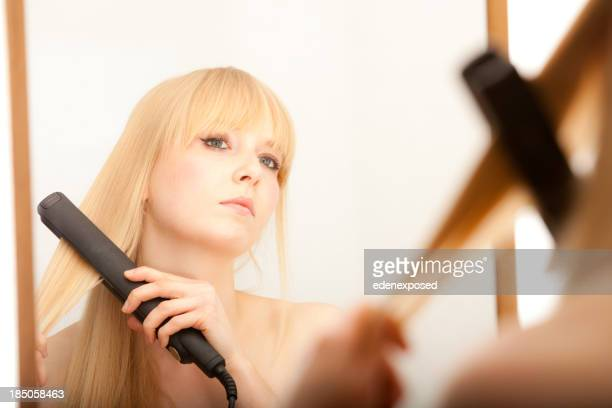 Hair Straighteners Stock Photos And Pictures Getty Images