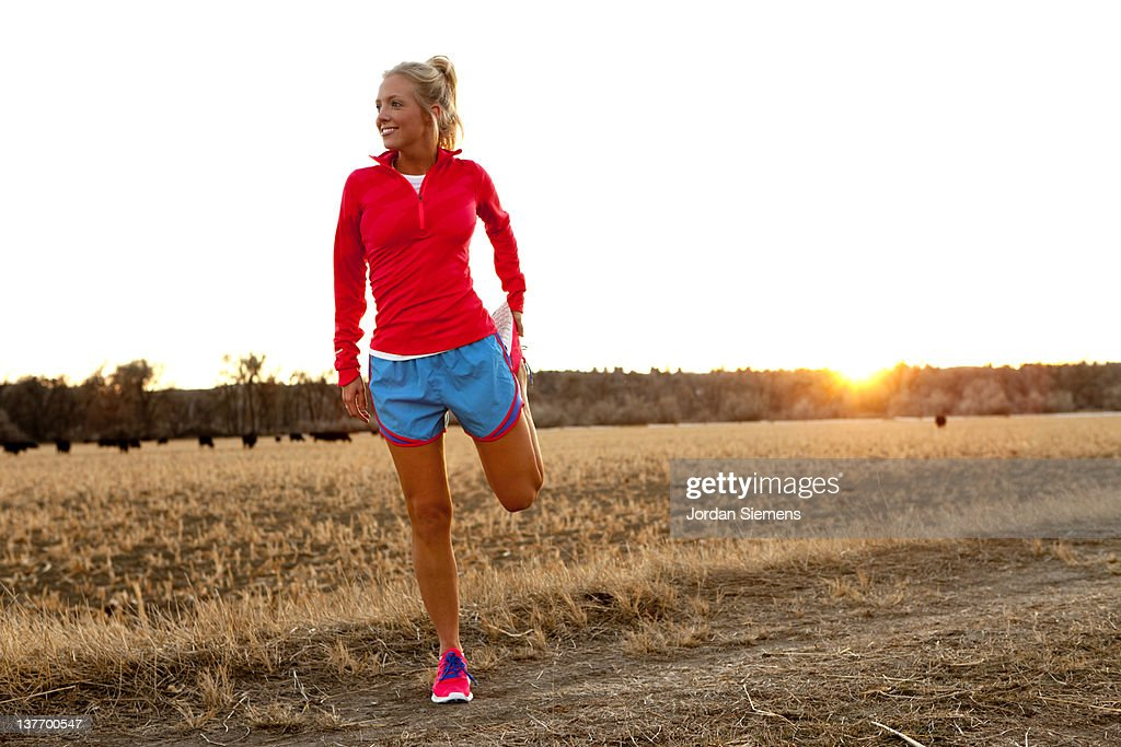 A female stretching before a run. : Stock Photo