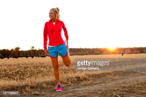 A female stretching before a run. : Stock Photo