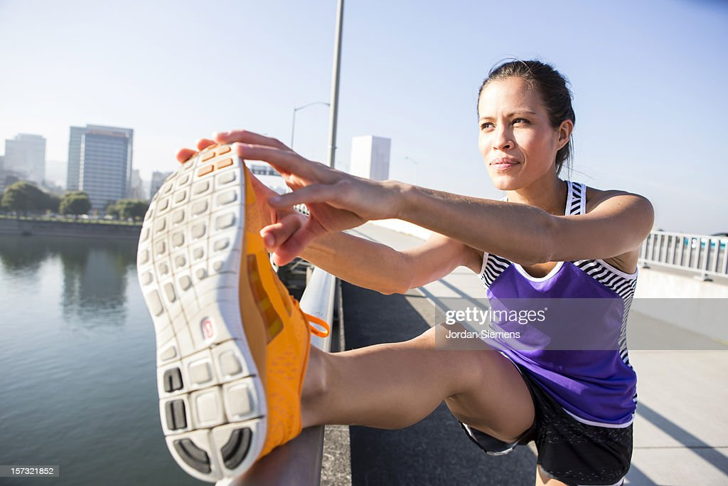Female stretching before a run. : Stock Photo