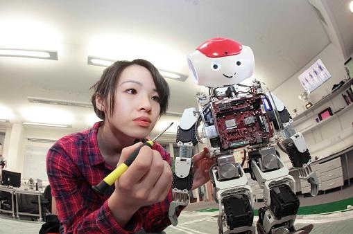 female student building robot