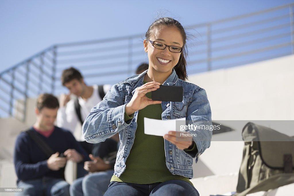 Female Student Depositing Check Through Mobile Phone