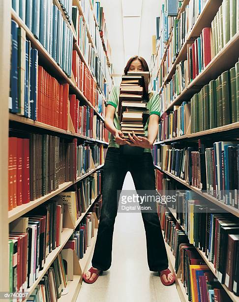 Female Student Holding a Pile of Books