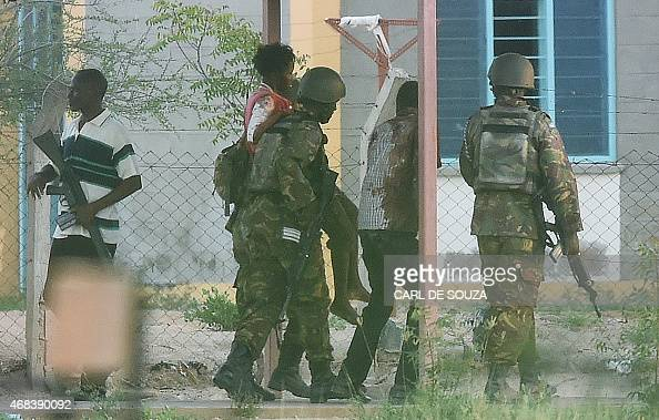 A female student hostage is escorted out of Garissa University after Kenya Defence Forces ended a siege by terrorist gunmen on April 2 2015 At least...