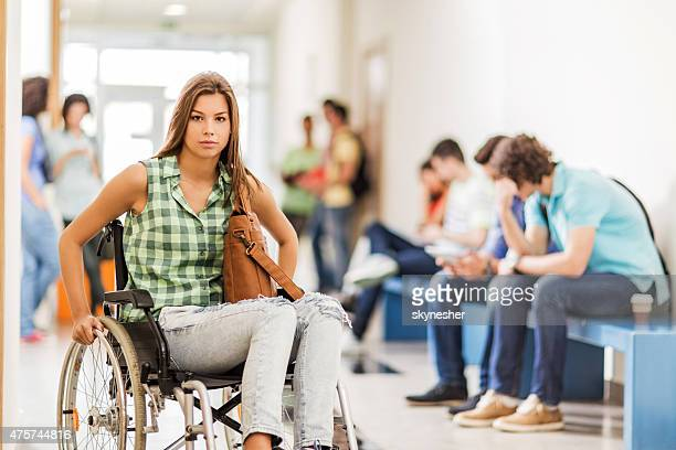 Female student in a wheelchair looking at camera.