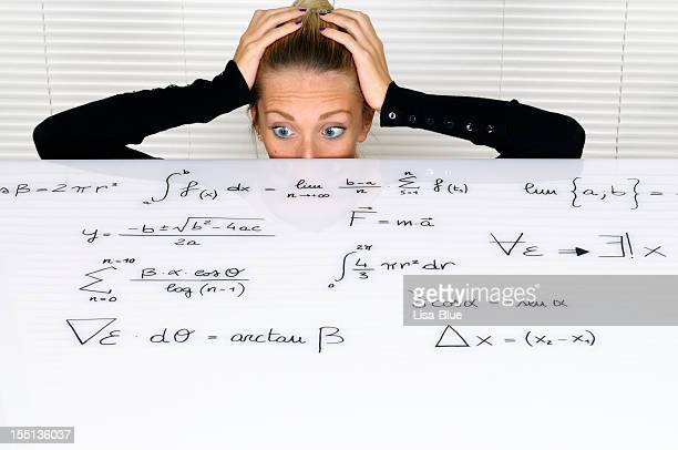 Female Student Looking At Formula