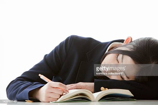 Female Student Lying on Textbook