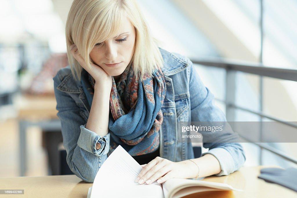 female student reading book : Stock Photo