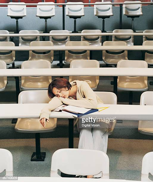 Female Student Sleeping in Lecture Hall