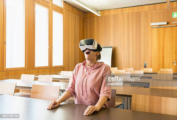 female student using VR Glasses at seminar room