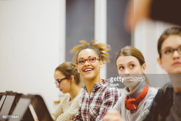 Female students at computer classes at university