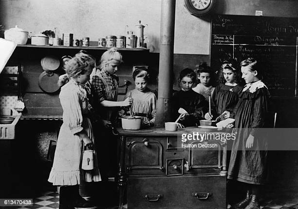 Female students attend a cookery class in a French school