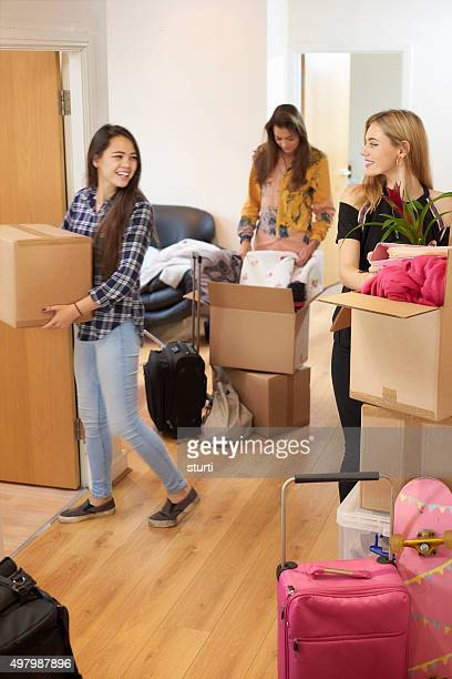 female students moving into new flat