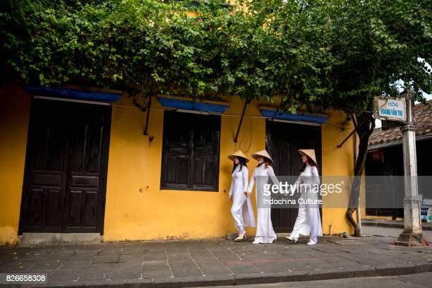 Female students wearing Vietnamese Ao Dai at Ancient town Hoi An, Vietnam