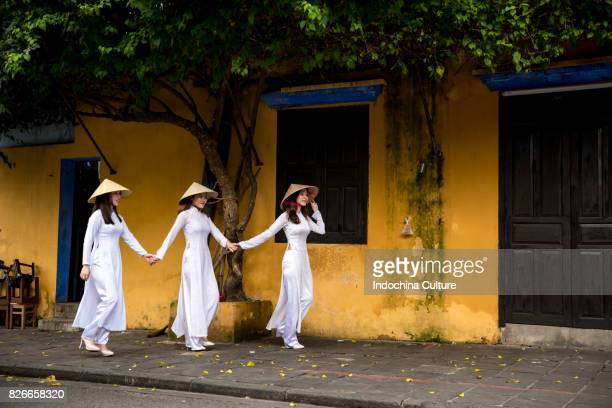 Female students wearing Vietnamese Ao Dai at Ancient town Hoi An, Vietnam