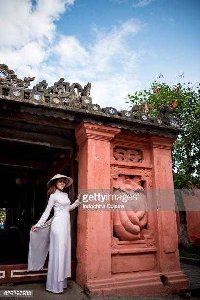 Female students wearing Vietnamese Ao Dai at Japanese Covered Bridge, Hoi An, Vietnam