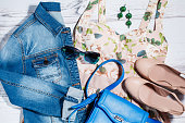 Female stylish romantic summer clothes collection - floral dress, denim jacket, leather bag, nude shoes, sunglasses