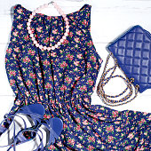 Female stylish romantic summer clothes collection - dark blue floral dress, blue leather , nude shoes, turquoise necklace