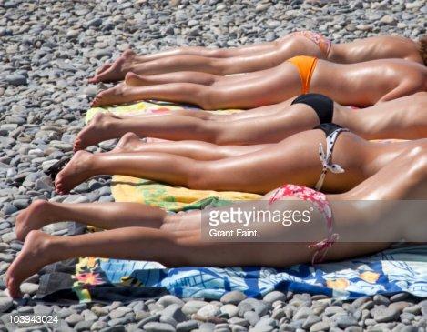Female sunbathers on beach, Nice.