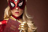 Female Superhero holding Bible