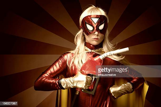 Female Superhero Holding Gas Nozzle