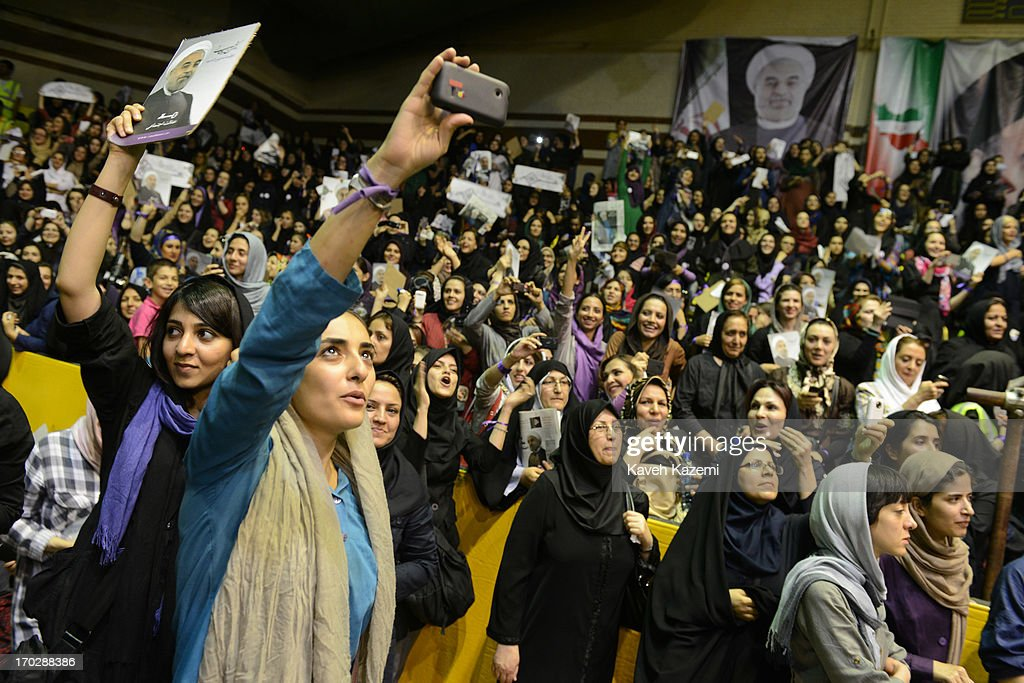 Female supporters of Hassan Rowhani, one of the eight candidates approved to run for the Iranian presidency seen holding his pictures during a campaign rally in Shiroudi stadium on June 8, 2013 in Tehran, Iran. Iran is to go to the polls for the Iranian general election on June 14, 2013.