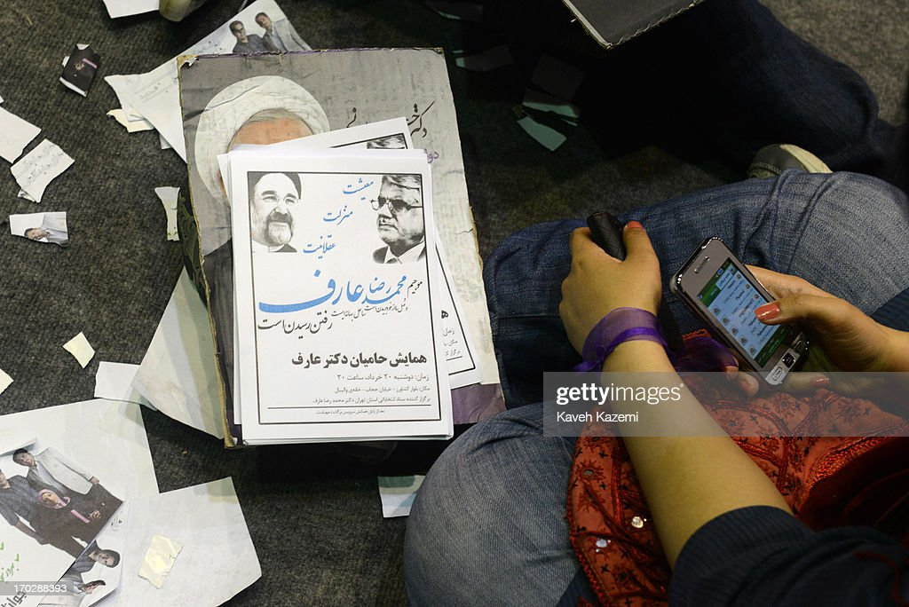 Female supporters of Hassan Rowhani, one of the eight candidates approved to run for the Iranian presidency sit on the ground with his pictures during a campaign rally in Shiroudi stadium on June 8, 2013 in Tehran, Iran. Iran is to go to the polls for the Iranian general election on June 14, 2013.