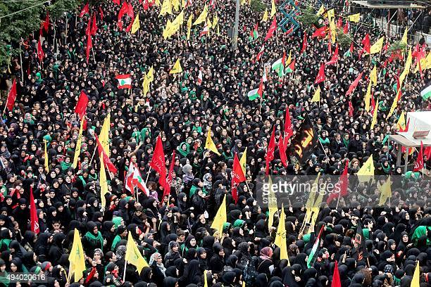 Female supporters of Lebanon's Shiite Hezbollah movement attend a rally marking Ashura on the tenth day of the mourning period of Muharram in...