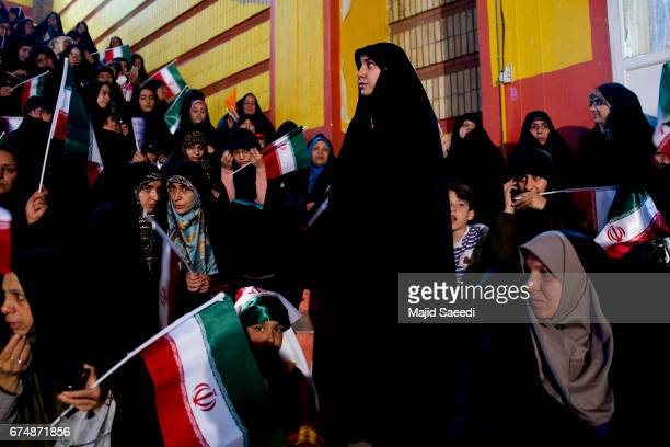 Female supporters of the Iranian cleric presidential candidate Ebrahim Raisi hold his posters as they attend a campaign rally April 29 2017 in Tehran...
