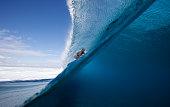 Female surfer in Cloud Break in Fiji