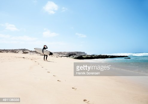 Female surfer on the beach