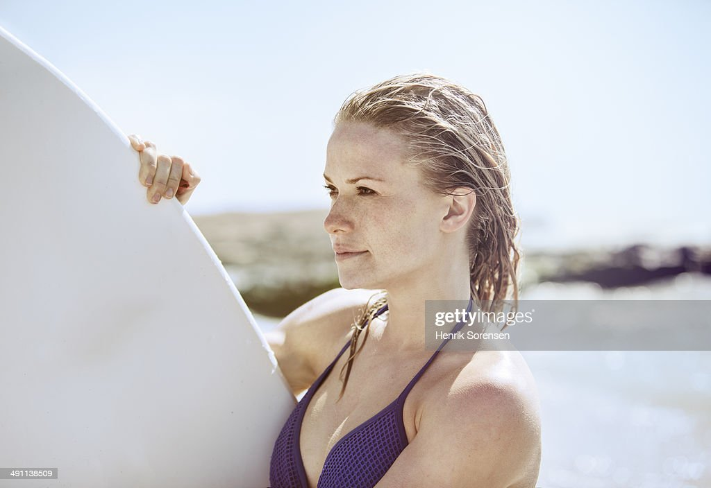Female surfer on the beach : Stock Photo