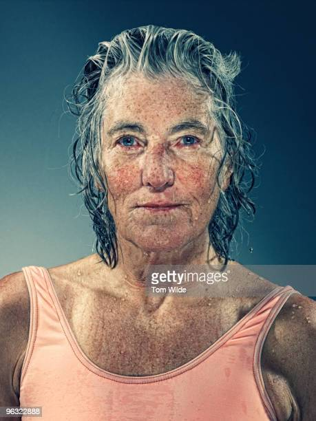 Female surfer with wet hair and face