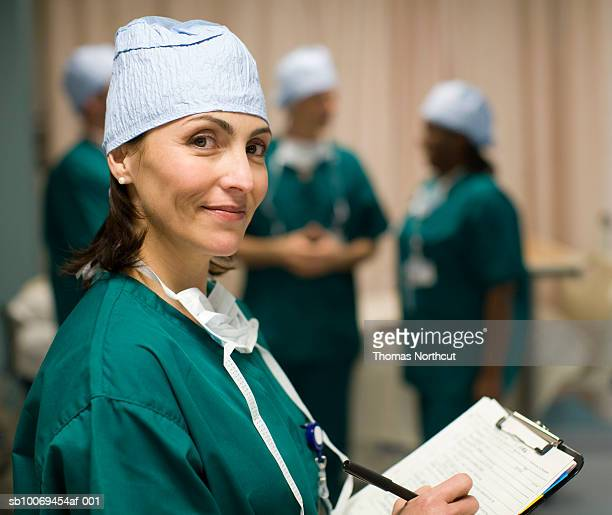 Female surgeon in operating room, portrait
