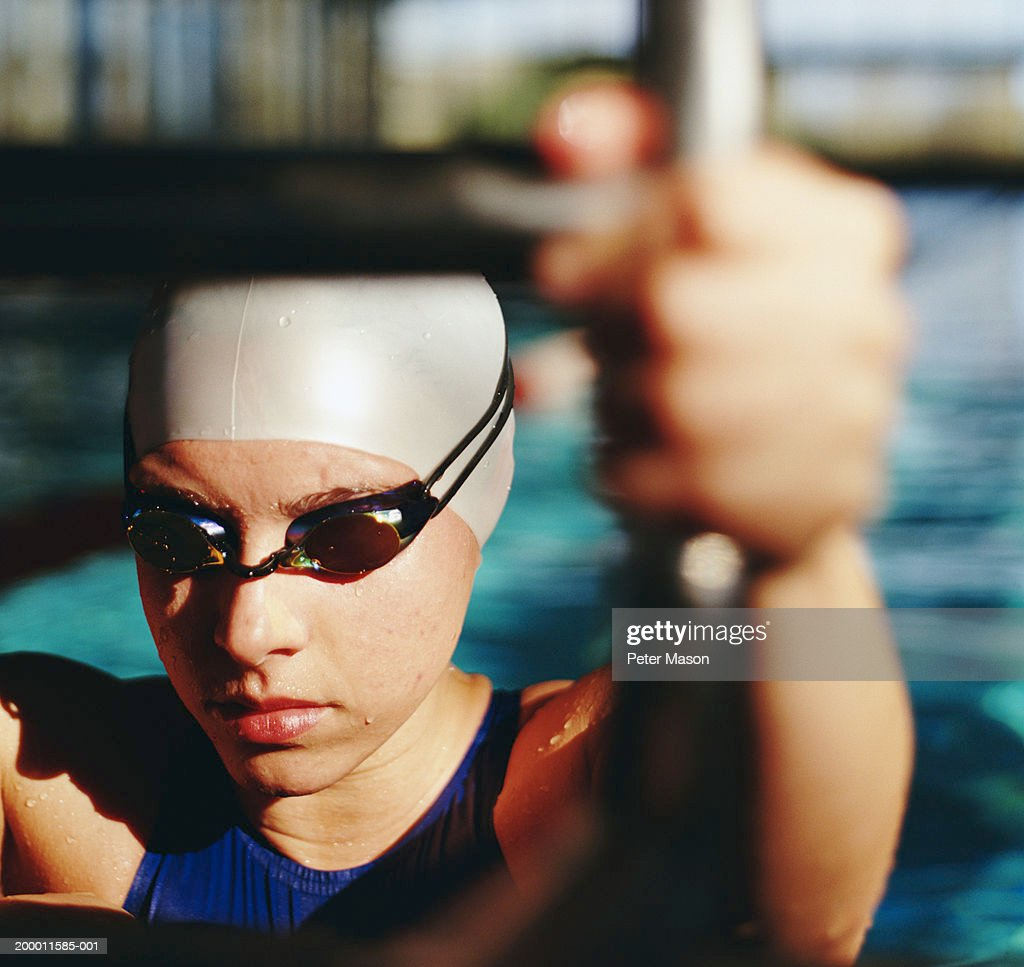 Female Swimmer Climbing Out Of Swimming Pool Closeup Stock Photo Getty Images