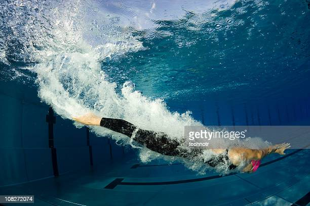Female swimmer diving, underwater shot