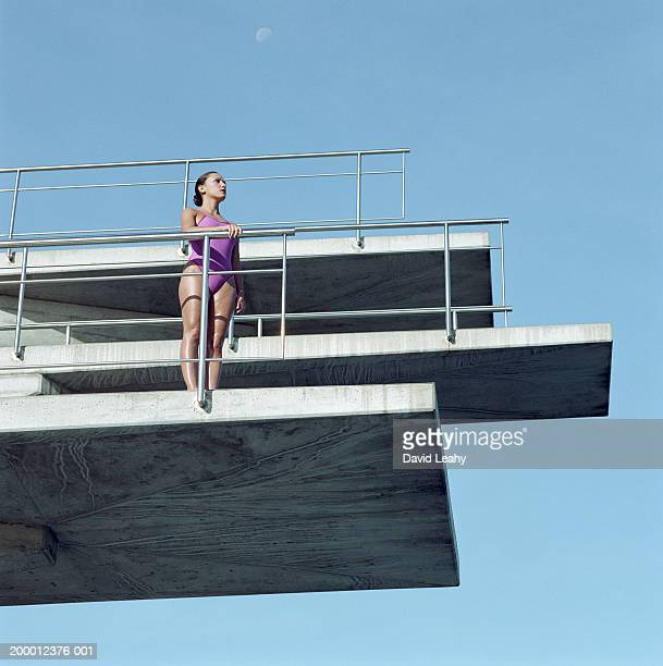 Female swimmer on diving board, low angle view