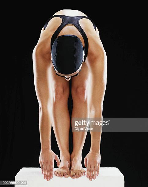 Female swimmer on starting block
