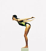 Female swimmer poised to dive