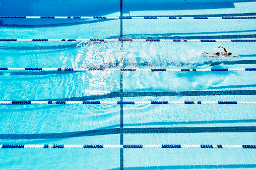 Female swimmer practicing alone in pool