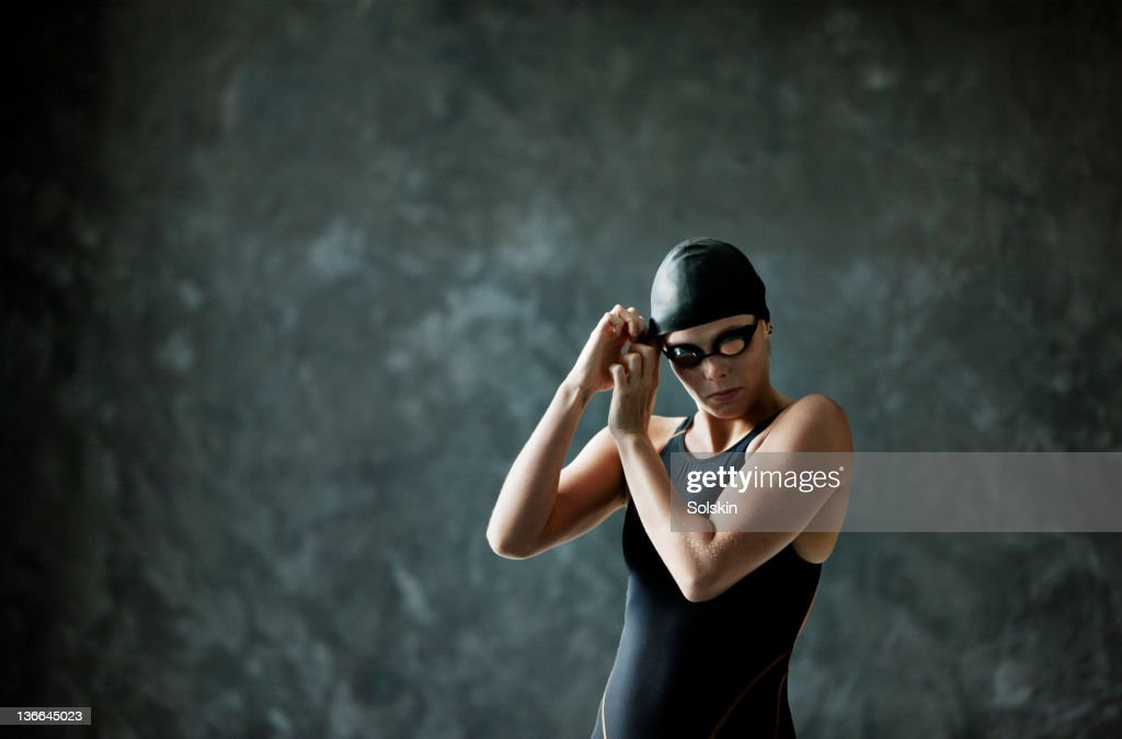 female swimmer preparing to compete : Stock Photo
