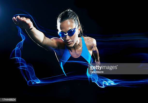 female swimmer swimming with light trails