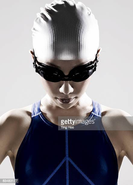 Female swimmer wearing swim cap and goggles