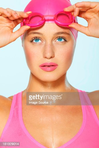 Female swimmer with pink goggles and cap