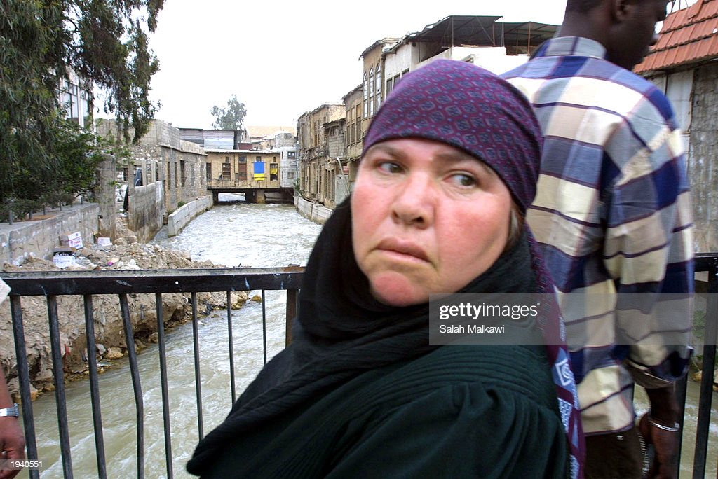 A female Syrian villager stands over the Barada River April 19 2003 in Damascus Syria Foreign ministers of countries bordering Iraq including Egypt...