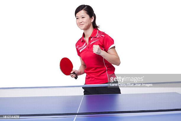Female table tennis player punching the air